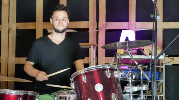Playing drums in studio. Concept of drummer rock