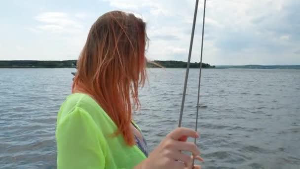 Pretty beautiful woman in romantic summer green dress on white yacht
