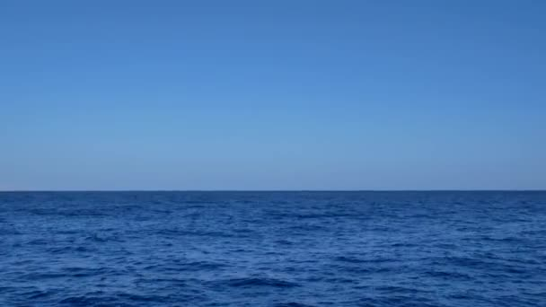Blue transparent water surface on sea or ocean with small waves from the wind