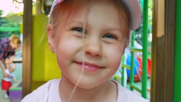 Little girl smiling at children playground