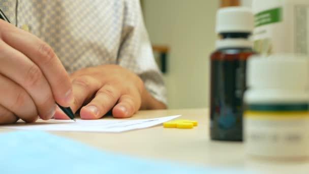 Doctor hand writing rx prescription