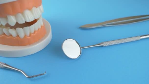 Dental instruments on blue background