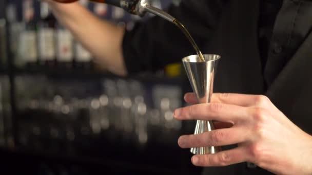 Barman making fresh alcoholic drink