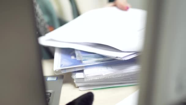 Busy woman in office doing paperwork