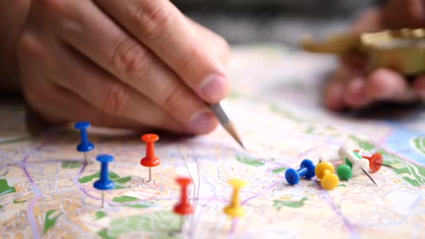 Men planning hiking trip on a map