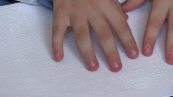 Child learning Braille at school