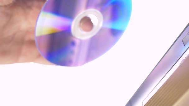 Hand insert DVD CD to dvd player