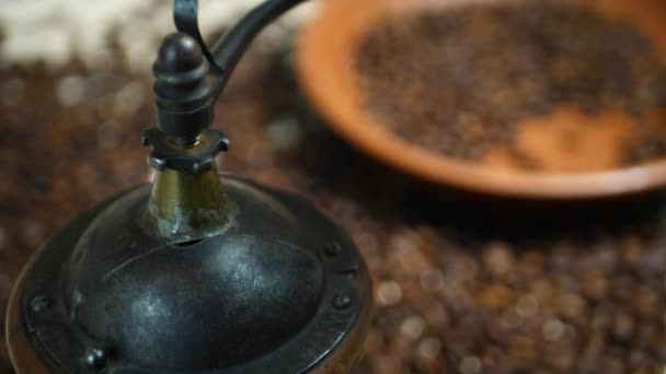 Hand of Barista Grinding Coffee Beans on Vintage Grinder