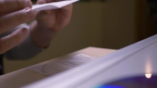 Hand insert DVD CD into dvd player