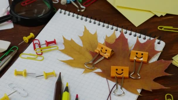 Smiles Yellow Binder Clip with Fallen Maple Leaves
