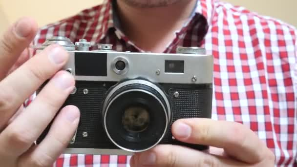 Photographer Holds in Hands Old Photo Camera