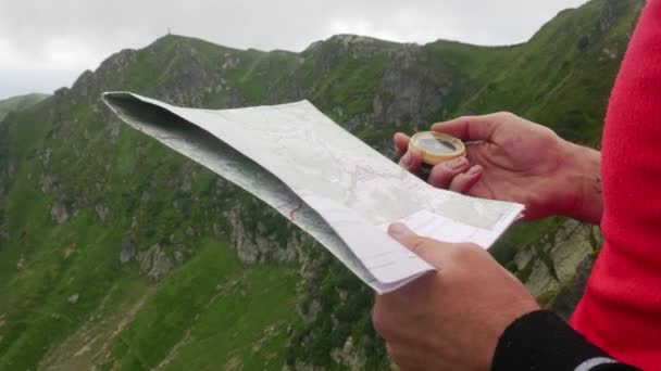 Planning Hiking Trip on Paper Map with Compass
