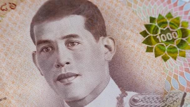 Brown 1000 baht paper banknote with face King of Thailand Maha Vajiralongkorn