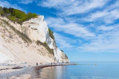 tourists at the beach of Mons Klint chalk cliffs