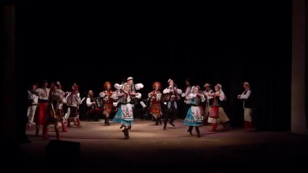 DNIPRO, UKRAINE - NOVEMBER 7, 2018: National traditions, customs and rites of the Ukrainian people performed by members of the Folklore Ensemble SLAVUTYCH  at the  State Drama  Theatre.