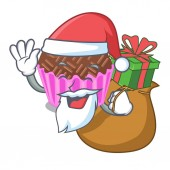 Photo Santa with gift brigadeiro is wrapped in a mascot vector illustartion