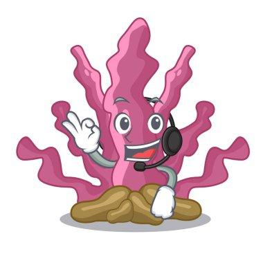 With headphone pink seaweed in the mascot aquarium
