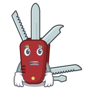 Afraid penknife cartoon on a wooden table