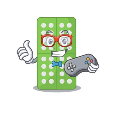 Cartoon Mascot design of medicine pills gamer using controller