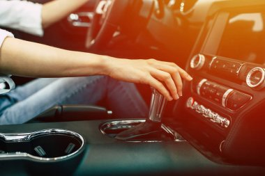 woman sitting in modern car, car interior view
