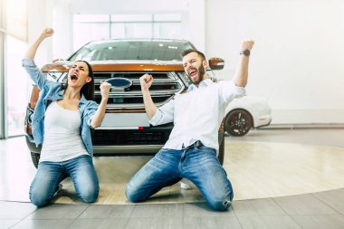 happy young couple exciting of buying new car in delarship