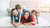 Fotografie Young family spending happy time at home
