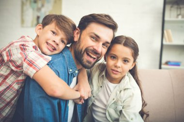 Young father spending time with children at home