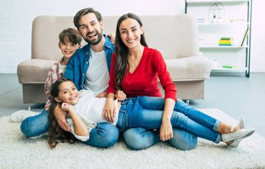 Young family spending happy time at home