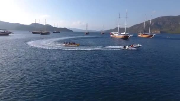 Marmaris, Turkey - September 2018: Amazing view to yachts sailing in open sea at sunny day with people swimming and doing watersports, Marmaris, Turkey