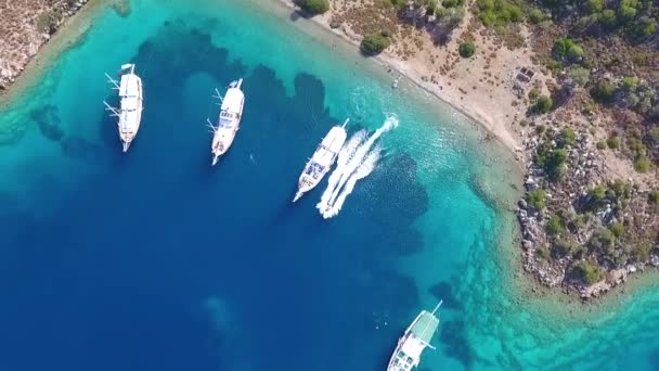 Marmaris, Turkey - September 2018: Amazing drone view of yachts in a bay of Aegean coast of Turkey with turquoise sea on a sunny day, Marmaris