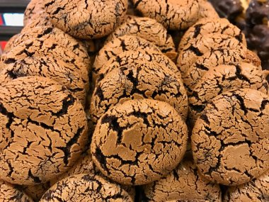 Stack of Crispy Chocolate Cookies for Sale at Showcase of Patisserie.