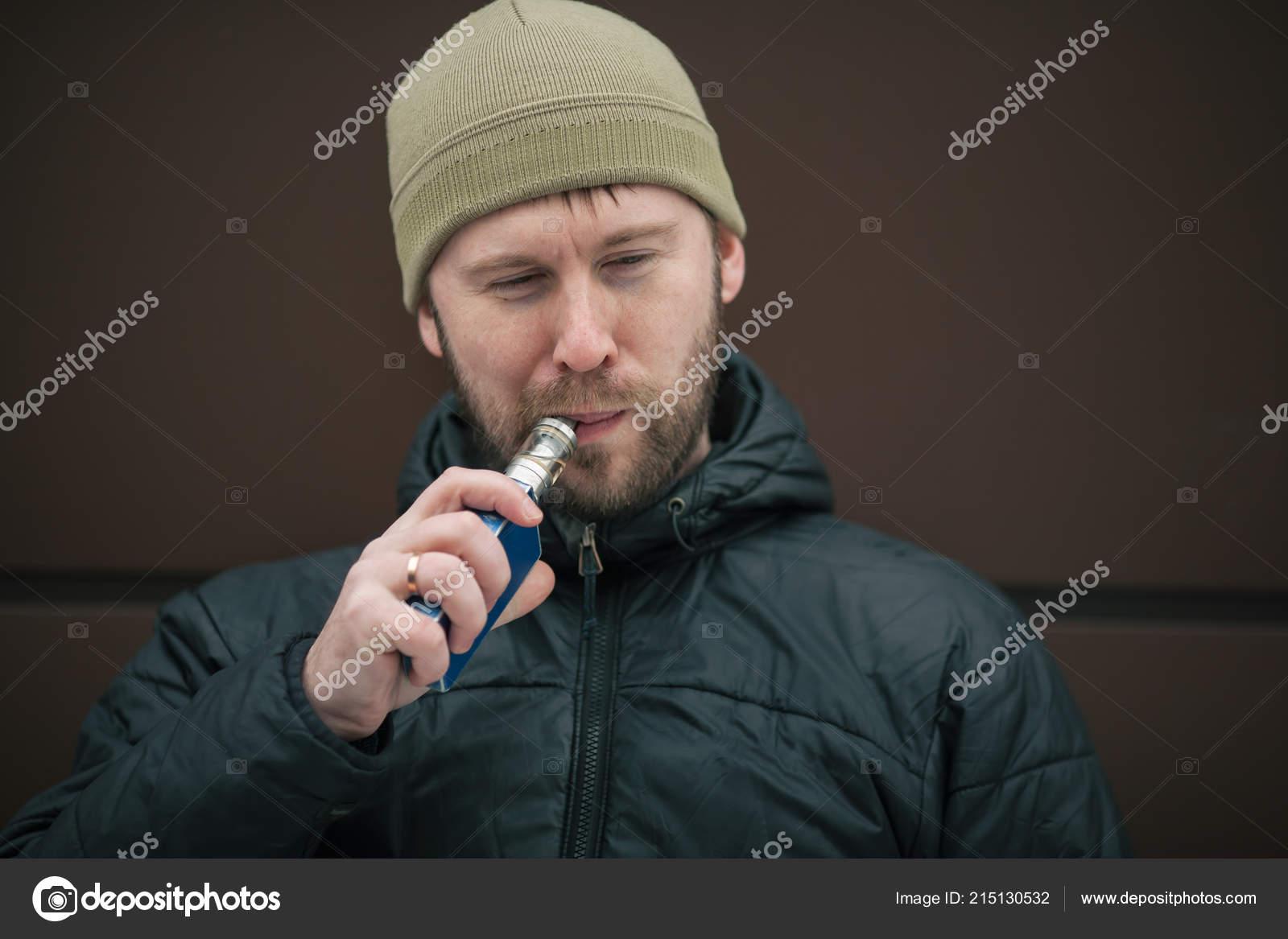 2d8efaa72bb Vape Man Young Bearded White Guy Cap Black Jacket Smoking — Stock Photo