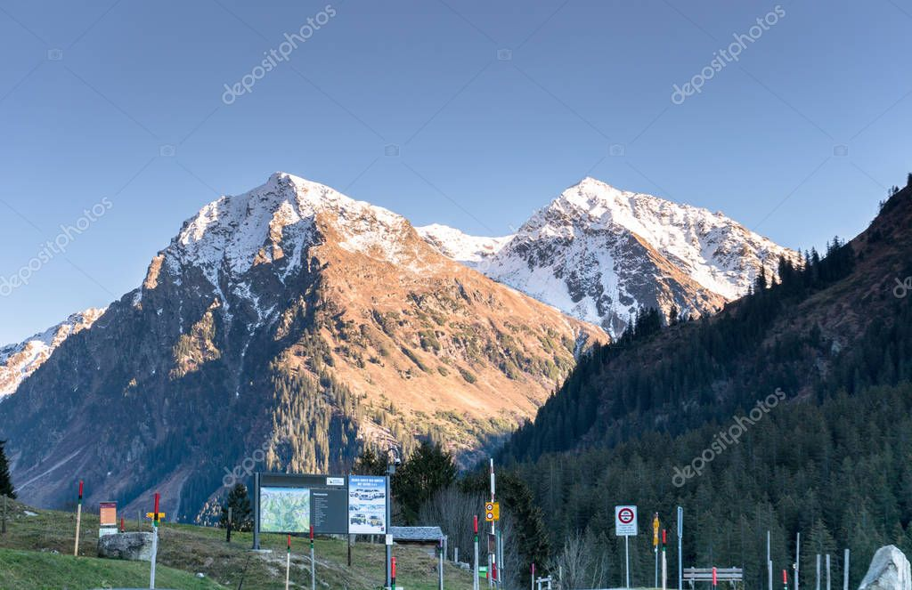 Monbiel, GR / Switzerland - November 18, 2018: idyllic mountain landscape defaced by numerous street signs and billboards and warning signs