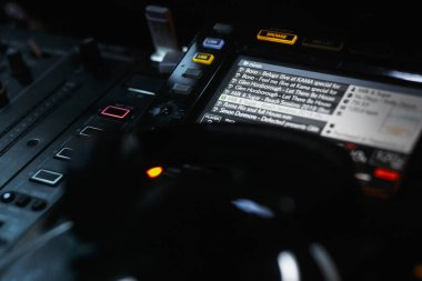 dj controller with tracks playlist on screen