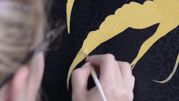 painter decorator draws a pattern of birds, close-up