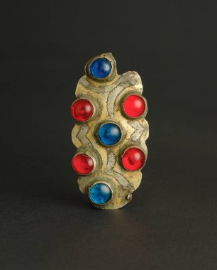 ancient antique brooch with stones on black background. Middle-Asian vintage jewelry