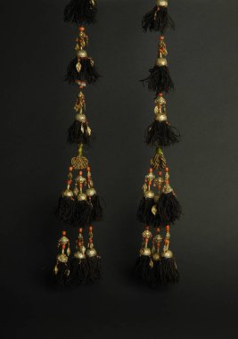 ancient antique earrings with stones on black background. Middle-Asian vintage jewelry