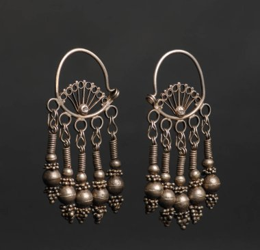 ancient antique earrings on black background. Middle-Asian vintage jewelry