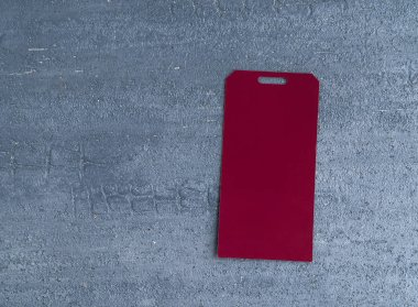 red price tag isolated on decorative textured background. top view