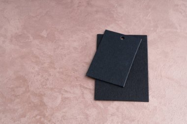 two black price tags isolated on decorative textured background