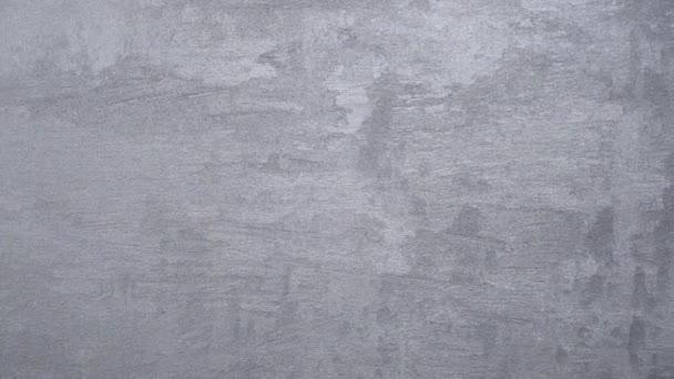 a vakolt textúra háttere márvány effekt szürke. művészi háttér kézzel. Velencei vakolat. eltolás hatása