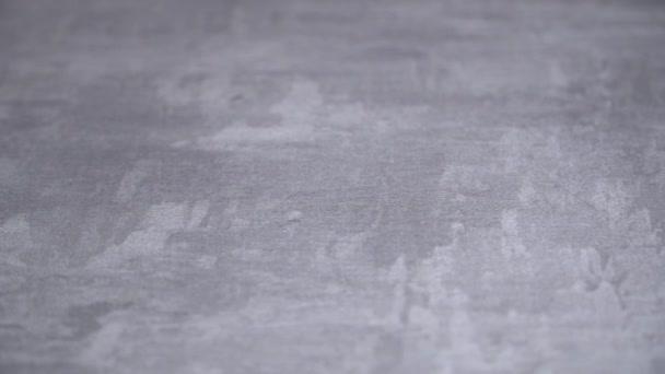 sfondo della texture intonacata con marmo effetto grigio. sfondo artistico fatto a mano. Intonaco veneziano. effetto di offset