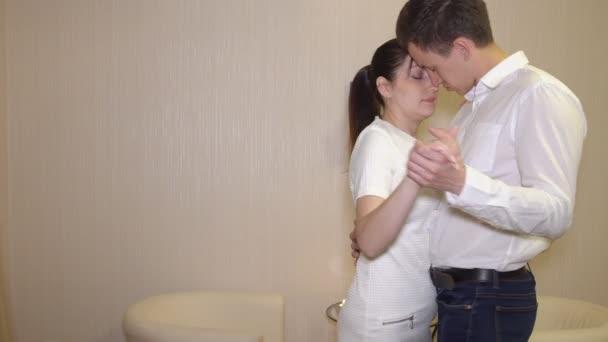 Beautiful man and woman dancing slow dance