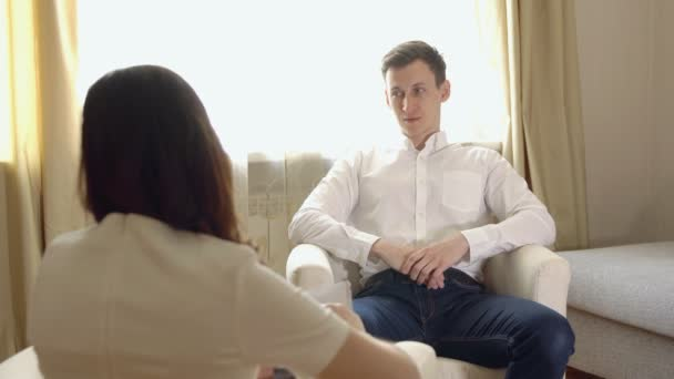 Young man at the reception of a woman psychologist