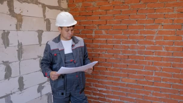 Working man with draft on site