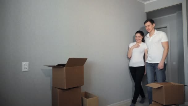Young couple very happy and excited about moving into new apartment