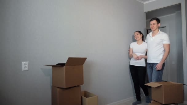 Moving to new apartment of young couple in love