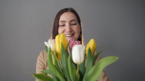 Beautiful woman gets bouquet of tulips, 4k