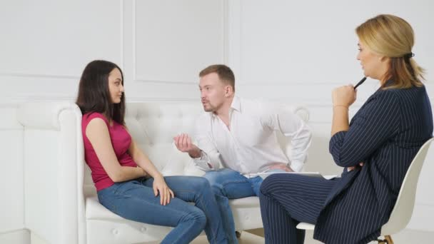 Young couple at a reception with a psychologist