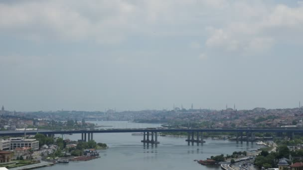 panoramic view of Turkish city with bridge crossing bay
